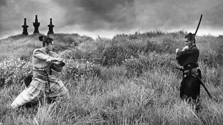 Two samurais standing ready to engage in a sword fight. Taken from the film Harakiri, by Masaki Kobayashi.