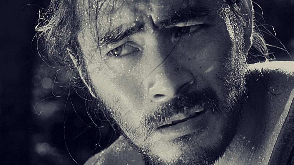 Toshiro Mifune looks at someone off-camera in disbelief. Taken from the movie Rashomon, by Akira Kurosawa.