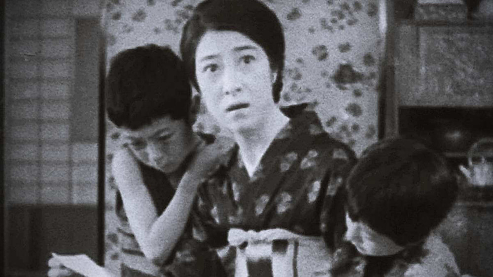 A mother of two looks up in surprise. Taken from the film Tokyo Chorus by Yasujiro Ozu.