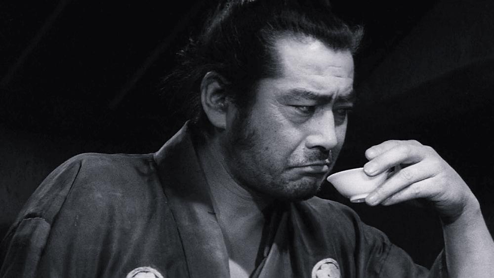 Toshirô Mifune drinks sake in the samurai film Yojimbo