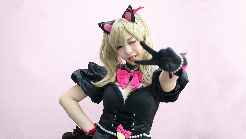 Kawaii Japanese girl giving the peace sign in cosplay outfit
