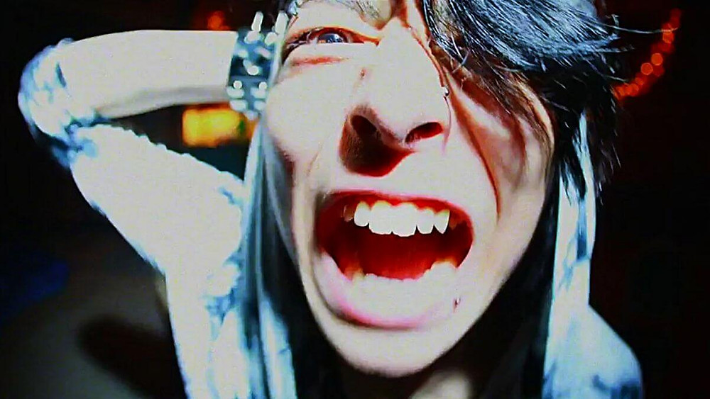 Strung-out Japanese teenager screaming in angst and torment.