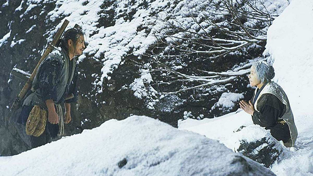 Man and woman looking exasperated in snowy mountain landscape. Taken from the film The Ballad of Narayama (1983).