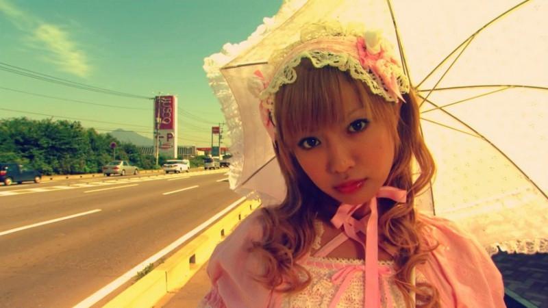 Japanese goth lolita girl standing beside the freeway. Taken from the film Kamikaze Girls.