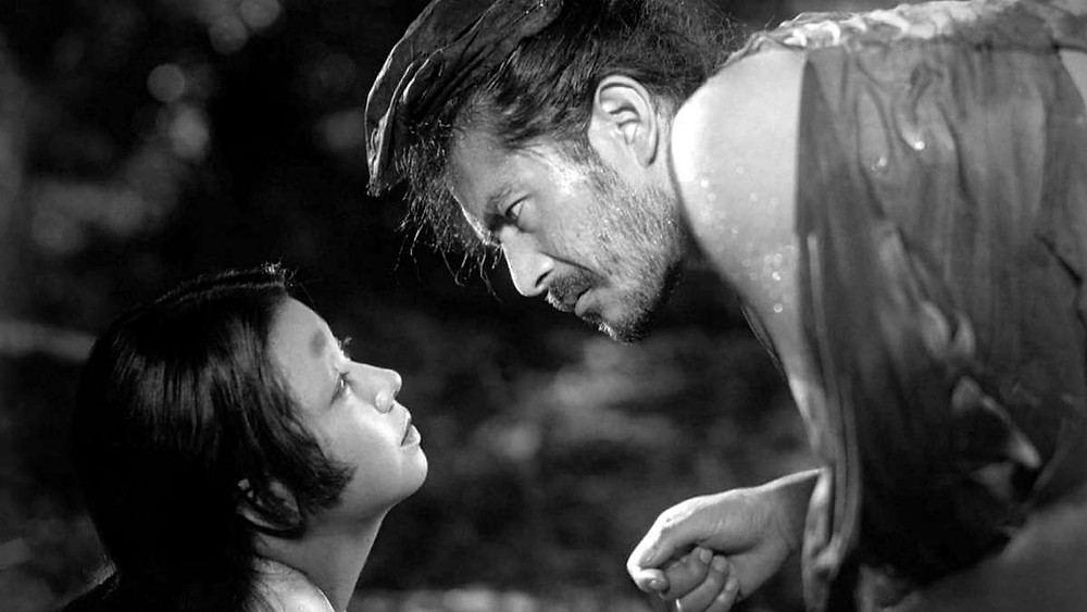 Toshiro Mifune looking deeply into the eyes of a strange woman. Taken from the film Rashomon, by Akira Kurosawa.