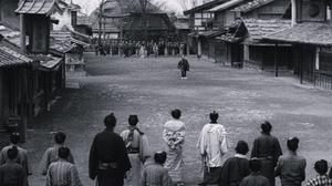 Dusty street with samurai showdown, from the film Yojimbo (1961)