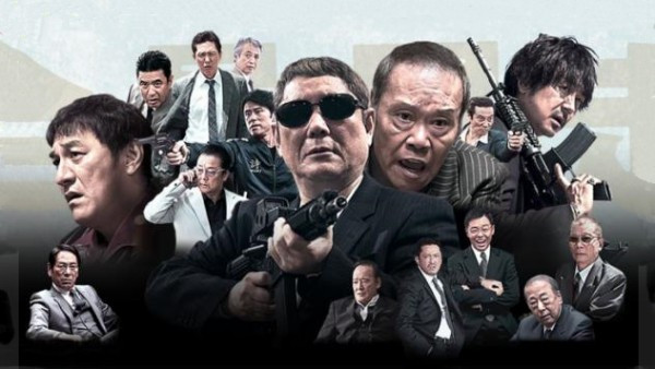 Takeshi Kitano is surrounded by a bunch of yakuza members. Taken from the Japanese film «Outrage».
