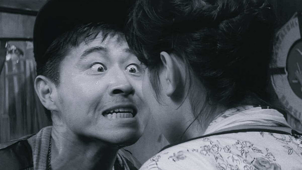 A young couple arguing. From the film «Pigs and Battleships» (1961).