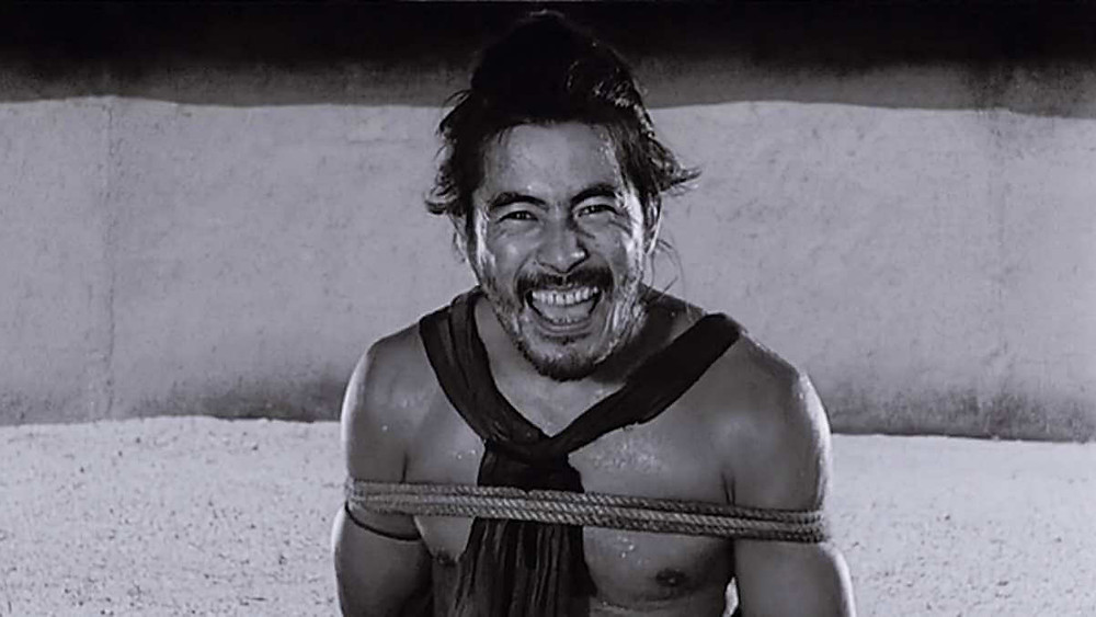 Toshiro Mifune laughing at the camera. Taken from the movie Rashomon, by Akira Kurosawa.