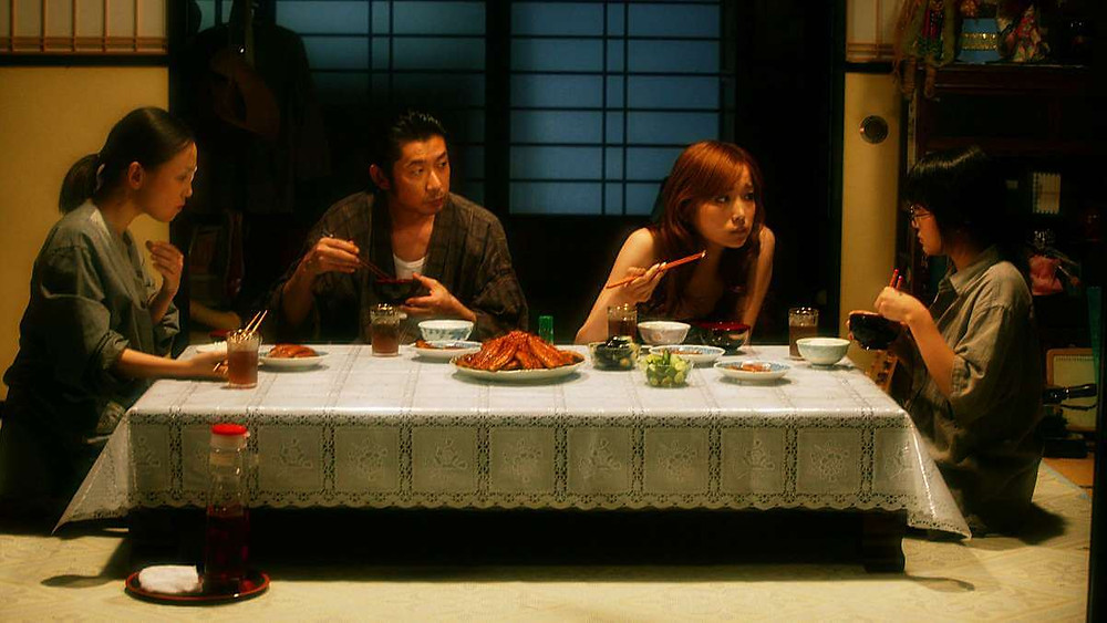 A serious conversation around a Japanese dinner table. Taken from the film «Funuke: Show some love, you losers!»