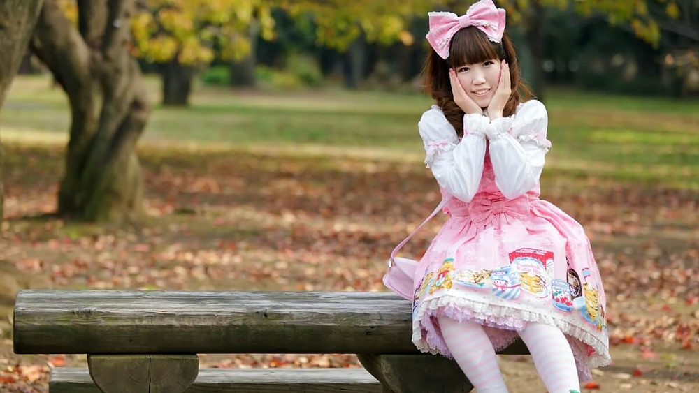 Kawaii Japanese girl sitting on a park bench in a cosplay outfit