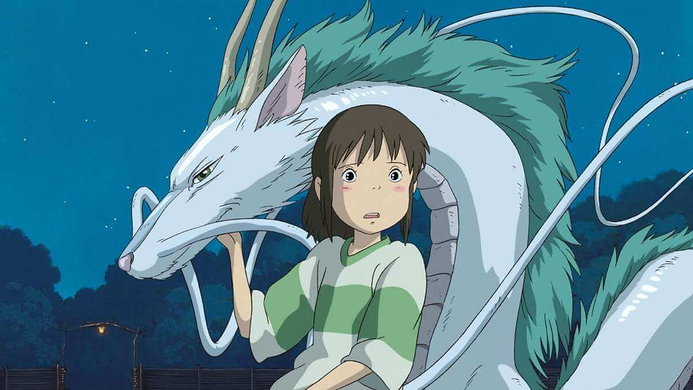 Chihiro looking bewildered while petting a dragon. Taken from the anime film Spirited Away.