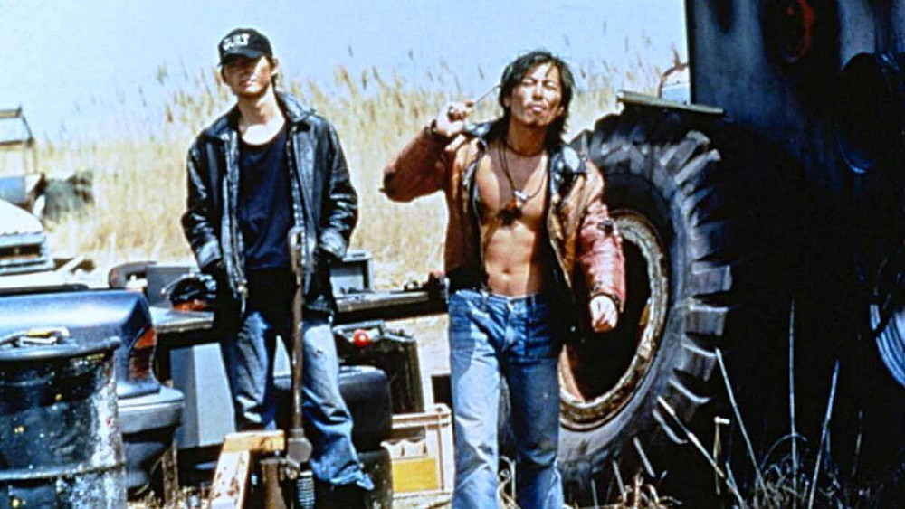 Two «hillbillies» looking for trouble. Taken from the movie Swallowtail Butterfly (1996).
