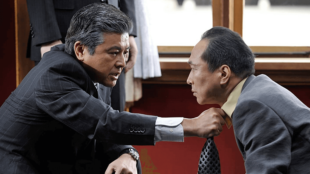 Yakuza threatening police in the Japanese film Outrage