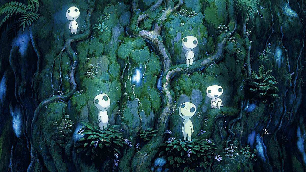Five Kodama standing in the forest. Taken from the anime film Princess Mononoke.