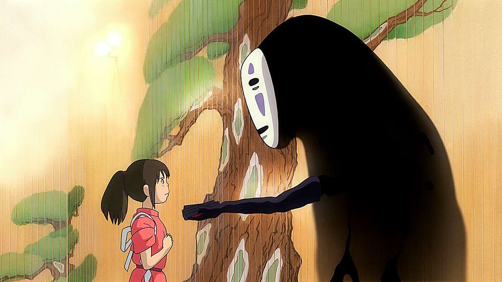 No-Face tries to give Chihiro a wad of cash. Taken from the anime film Spirited Away.