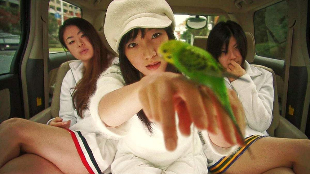 Three sect members from the movie Love Exposure by Sion Sono