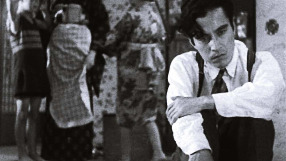 A father sitting down in exasperation. Taken from the film Tokyo Chorus by Yasujiro Ozu.