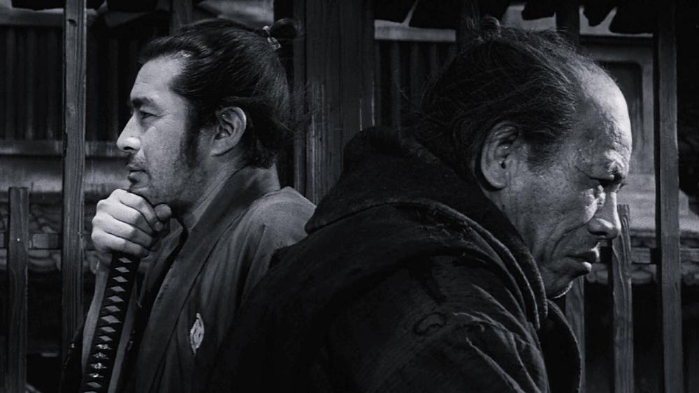 A samurai and an innkeeper are thinking, in a scene from Yojimbo by Akira Kurosawa