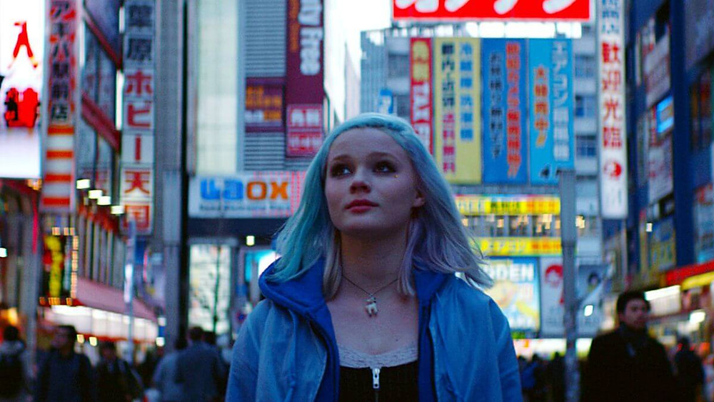 Scene from the Norwegian film Harajuku (2018). It shows a teenage girl walking through Tokyo streets.