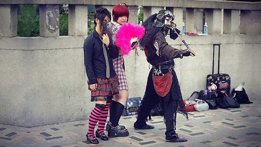 Harajuku kids dressed up in cosplay outfits.