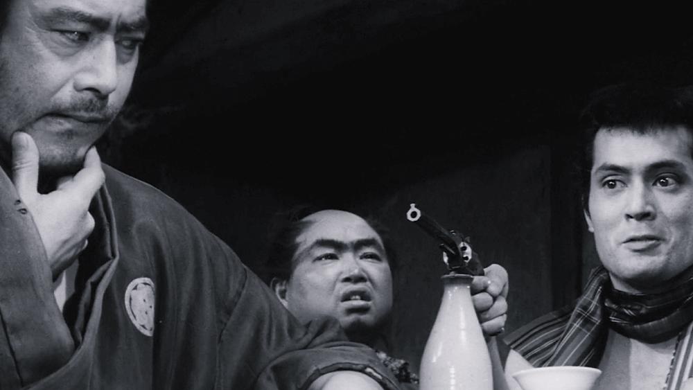 Three samurais discussing. Scene from the movie Yojimbo by Akira Kurosawa