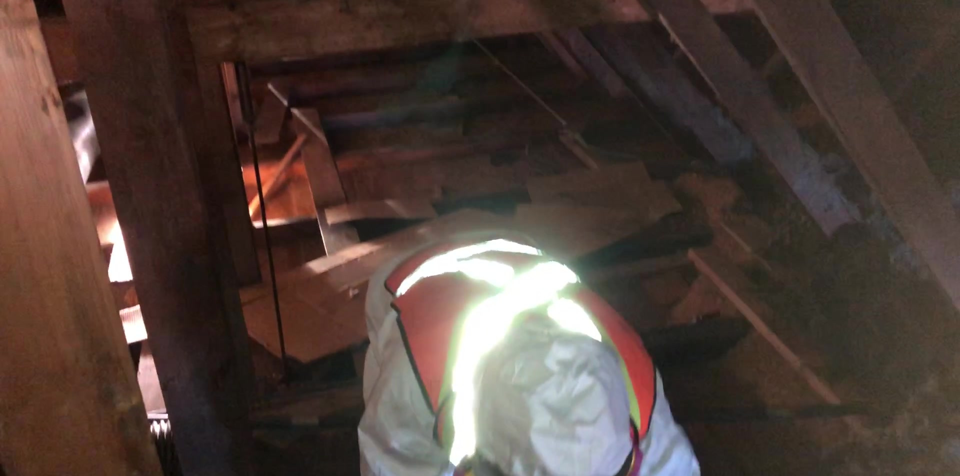 Removal of woodchips and rock wool from an old attic space.