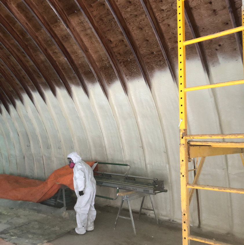 Spraying of closed cell foam on a wood barn at R-18