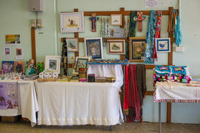 Debbie's colourful display with Norma's crocheting on the right and Debra O'Halloran's fairys and books on the left.