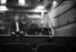 Joe sitting on stage
