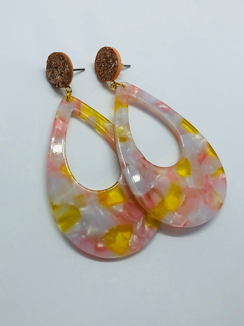 It's resin - multicolor polaris with soft pink, yellow & white