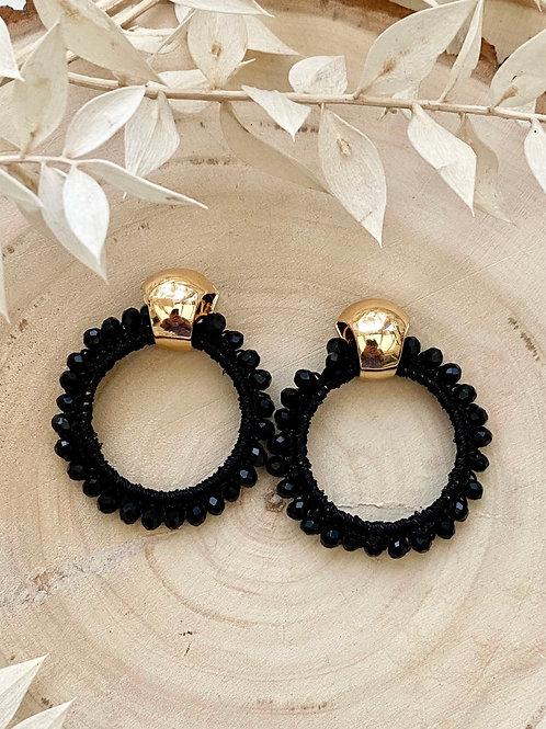It's gold - black beads circle