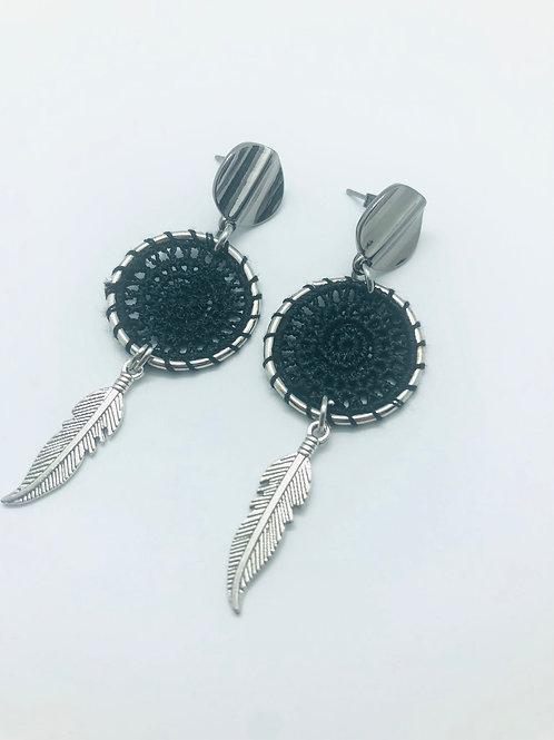 It's silver - black dreamcatcher & feather