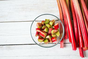 rhubarb stems on wooden surface.jpg
