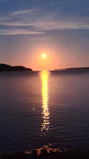 Rising full moon over Manukau Harbour.
