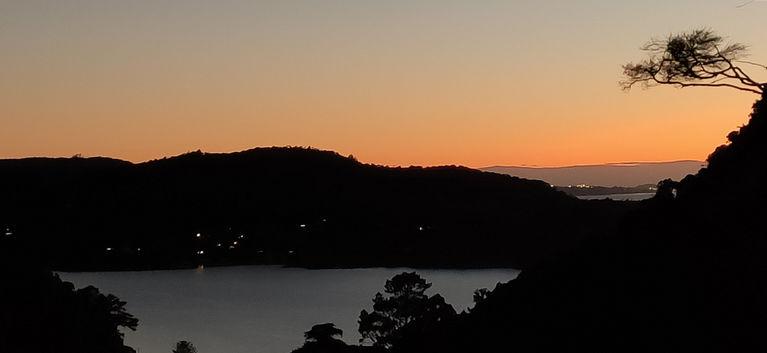 Sun rise over Big Huia Bay.