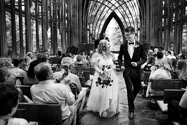 bride and groom exiting a chapel