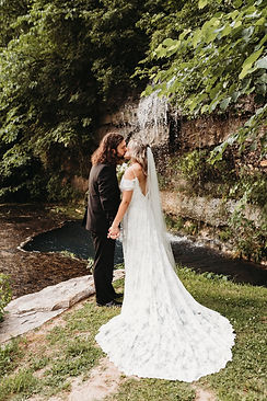 couple kissing under a waterfall