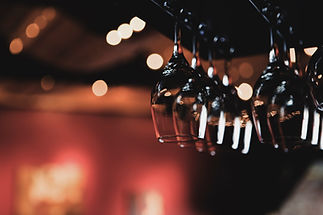 Wine Glasses Hanging from Rack