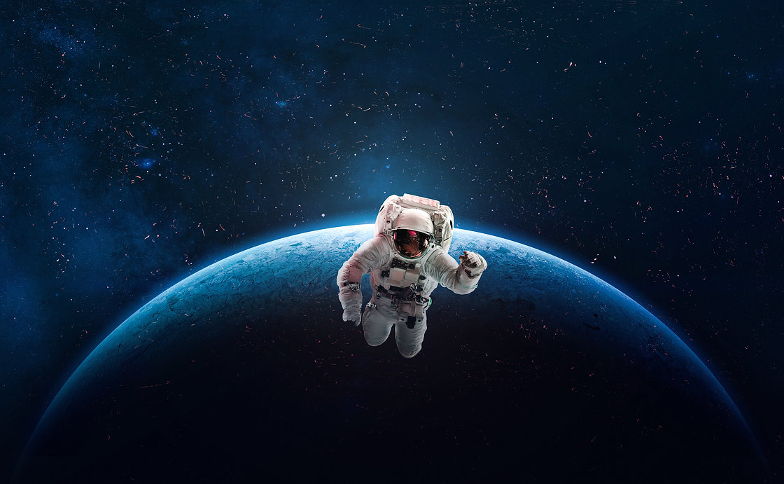 Astronaut in outer space over of the planet Earth. Colorful beautiful planet. Milky way. B