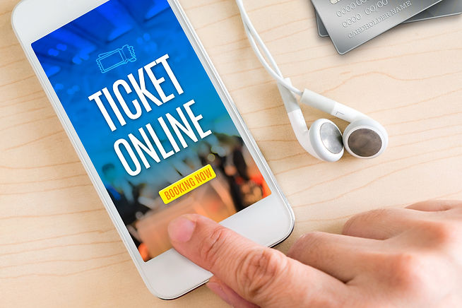 Hand touch smart phone and ear phone with Ticket online word on wood table ,Online payment