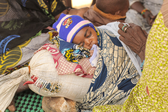 A baby sleeps on a World Food Programme grain sack