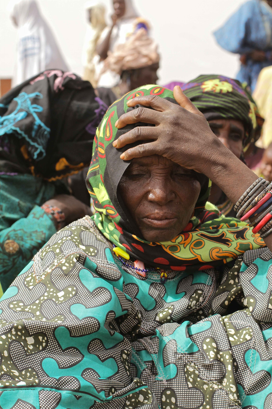 refugee waits for food distribution .jpg