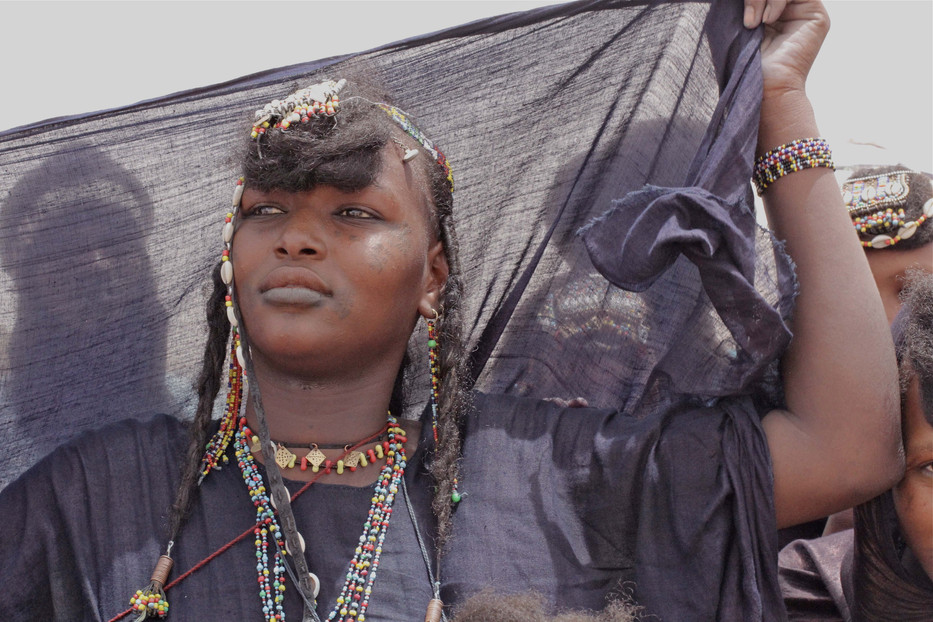 A Tuareg refugee girl dancing to celebrate Eid.