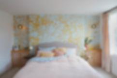 Bespoke handmade bedroom cabinets wit brass detailing