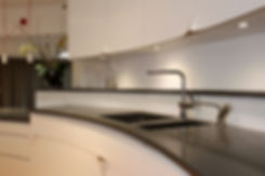 Contemporary curved kitchen by Splinter Works