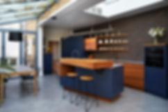 Designer townhouse kithcen wit blue and copper by SplinterWorks