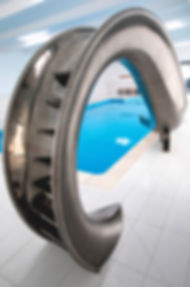Designer swimming pool slide by splinterworks