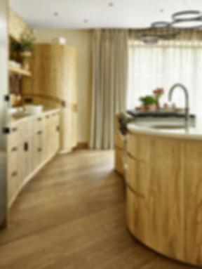 Organic curved kitchen design by Splinter Works