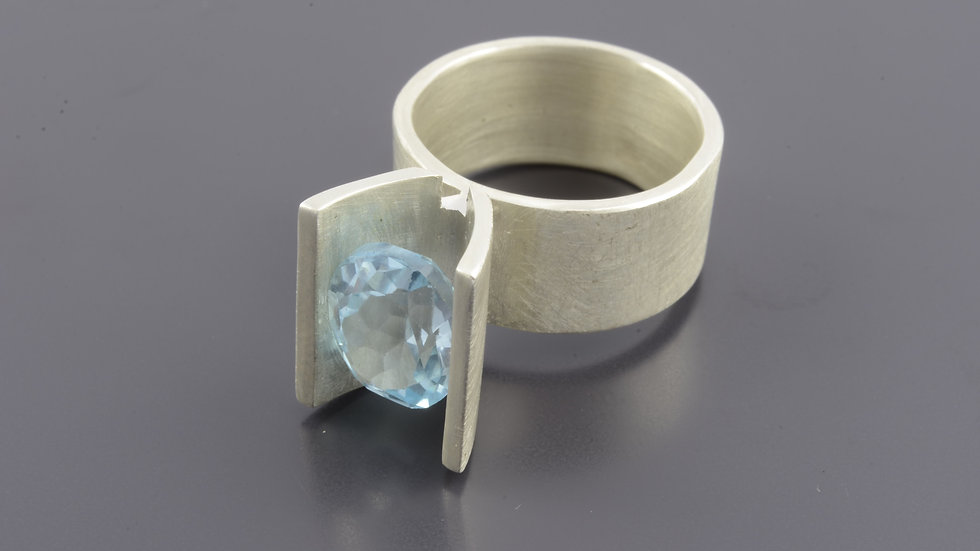 Brushed silver Ring with blue topaze stone